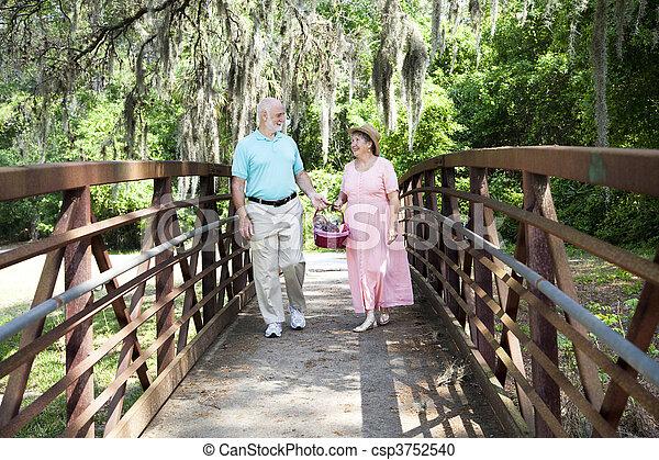 Seniors Strolling in Park - csp3752540