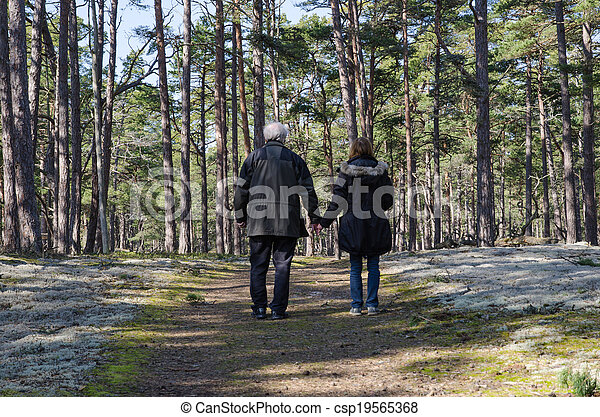Seniors walking in the forest - csp19565368