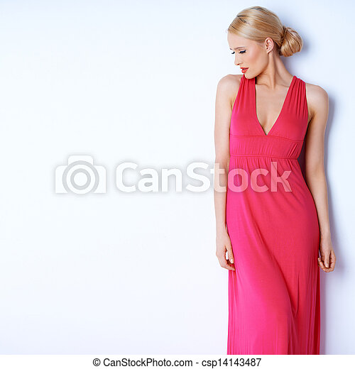 Sensual blond woman posing in pink dress - csp14143487