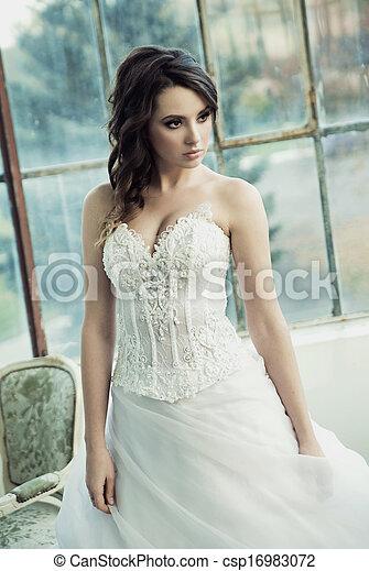 Sensual bride wearing pretty wedding gown - csp16983072