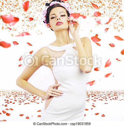 Sensual brunette lady with the rose petals in the background - csp19031959