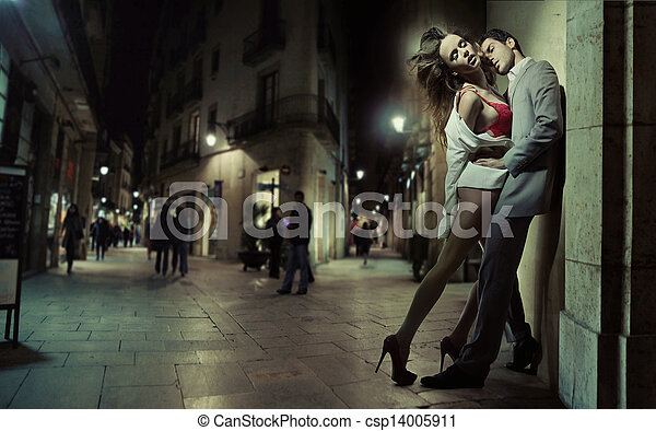 Sensual loving couple kissing in the dead of the night - csp14005911
