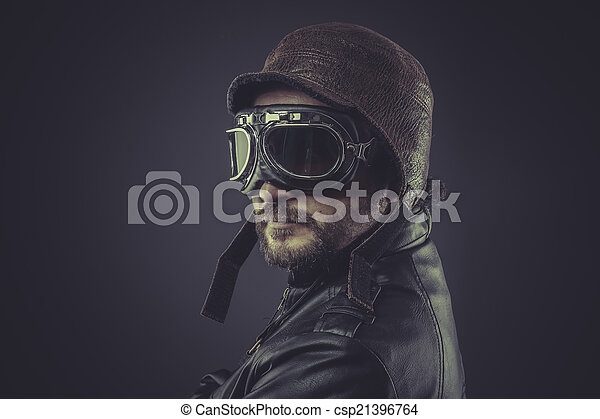 sensual, pilot dressed in vintage style leather cap and goggles - csp21396764