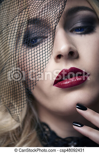 Attractive Adult Woman Leaning Face on Hand - csp37970014