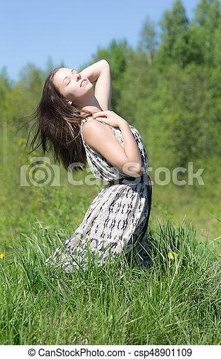 Sensual woman on green grass - csp48901109