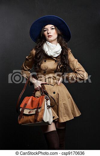 sensual woman portrait on dark background - csp9170636
