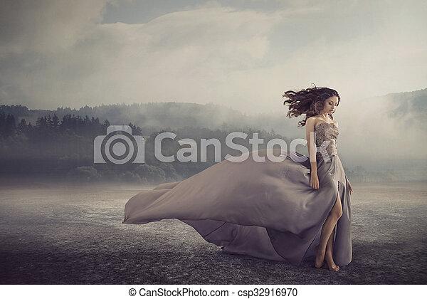 Sensual woman walking on the fantasy ground - csp32916970