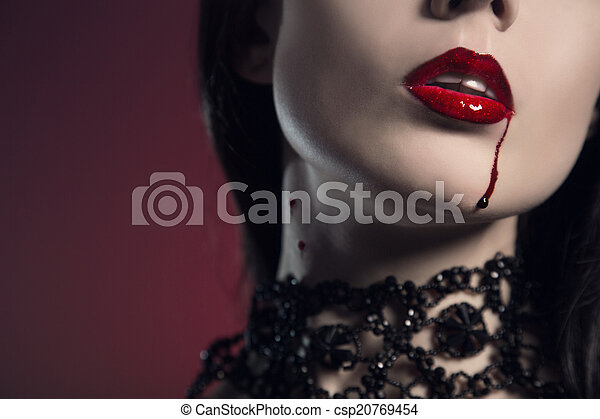 Sensual young woman with red lips bitten by vampire  - csp20769454