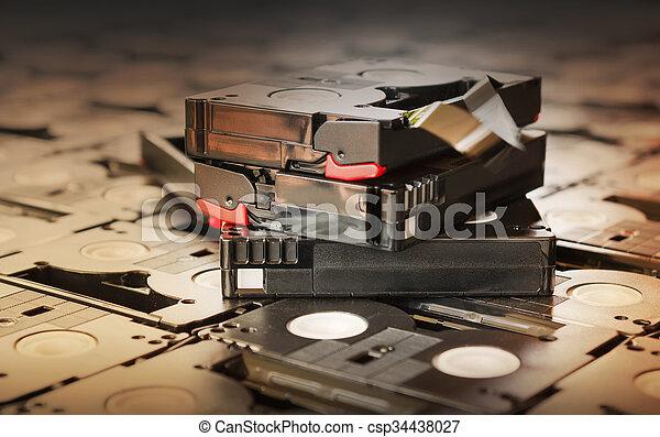 Sepia antique colour abandoned pile of old useless mini DV (video recording cassette tape) - csp34438027
