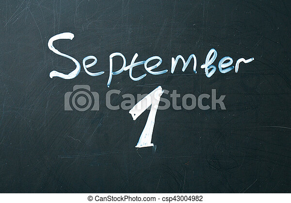 September 1 The phrase written in chalk on the blackboard. - csp43004982