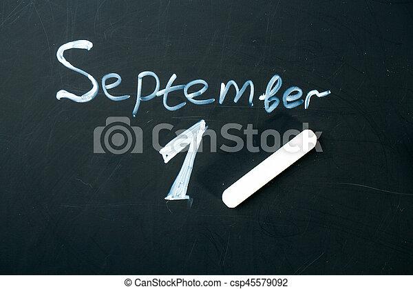 September 1 The phrase written in chalk on the blackboard. - csp45579092
