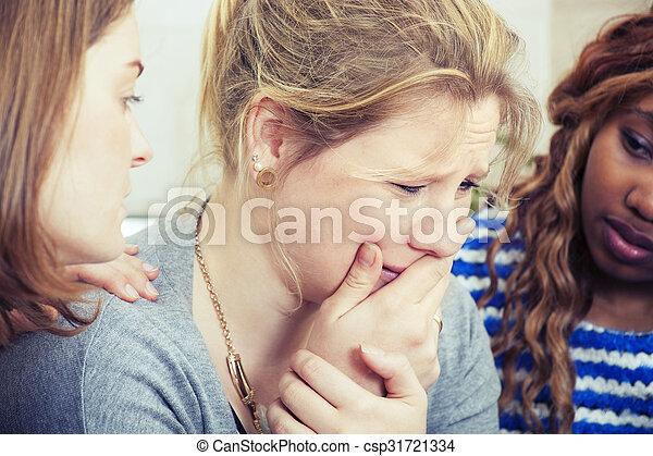 Una mujer triste siendo consolada por un amigo - csp31721334