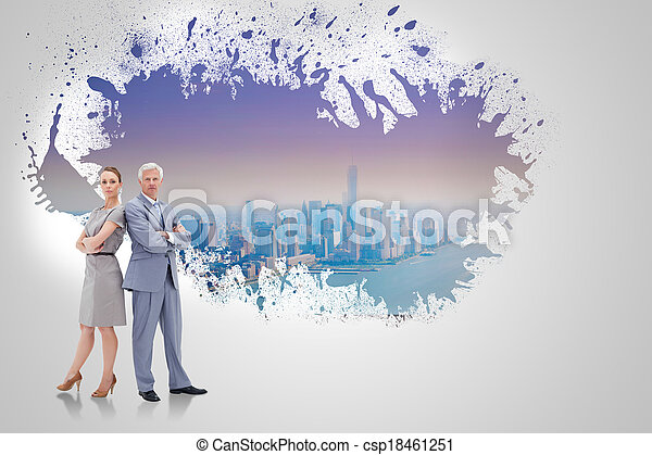 Serious businessman standing back to back with a woman  against splash on wall revealing cityscape - csp18461251