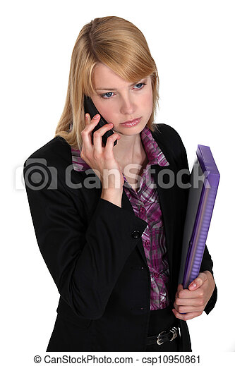 Serious businesswoman with files and a phone - csp10950861