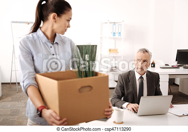 Serious competent businessman working with laptop - csp47113290