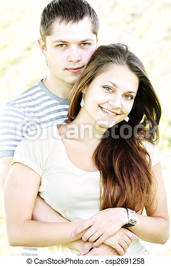 Serious guy and smiling girl - csp2691258