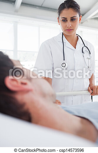 Serious nurse taking care of a patient - csp14573596