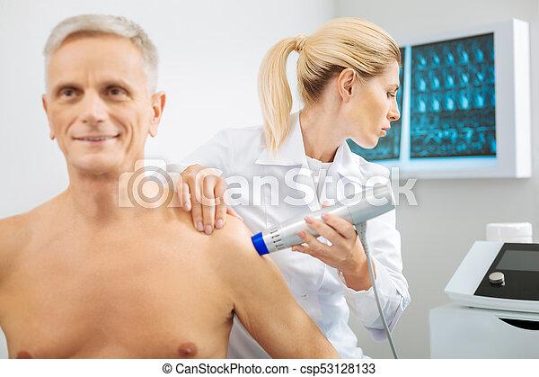 Serious smart woman looking at the monitor - csp53128133