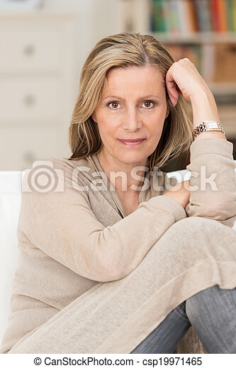 Serious thoughtful middle-aged woman - csp19971465