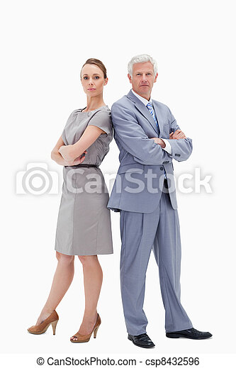 Serious white hair businessman back to back with a woman - csp8432596
