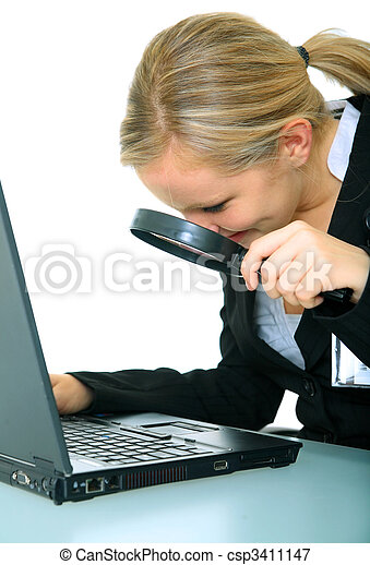 Serious Young Businesswoman Examine Computer - csp3411147