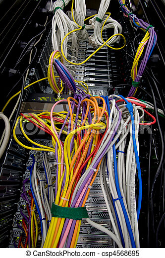 Server data wires and cables. A server rack with a mess of... stock ...