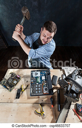 Service Engineer With Sledgehammer Brakes Laptop And Computer
