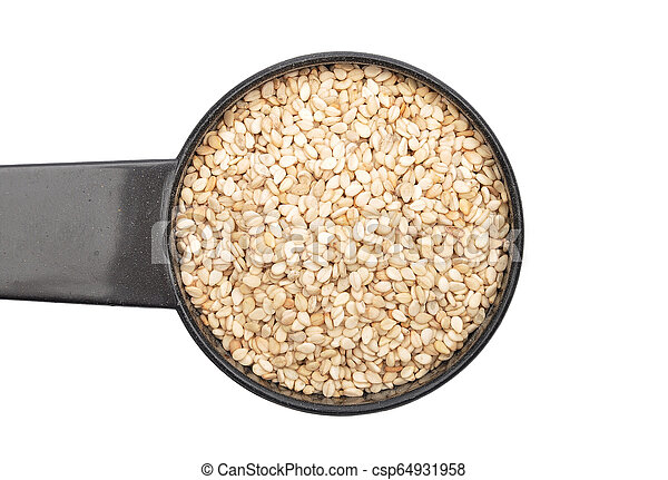 Sesame in measuring spoon on white background - csp64931958