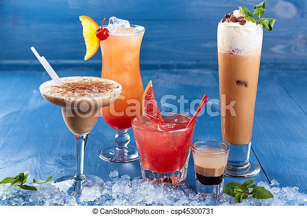 Set of alcoholic cocktails on blue background - csp45300731