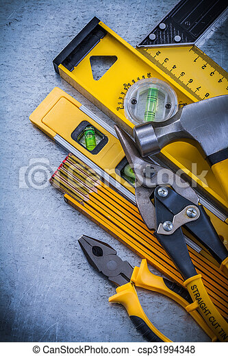 Set of construction tools on scratched metallic background - csp31994348