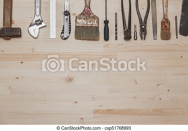 Set of different tools on wooden background - csp51768993