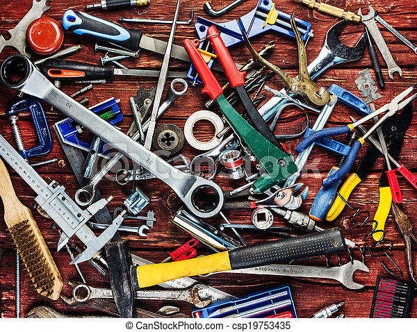Set of different tools on wooden background - csp19753435