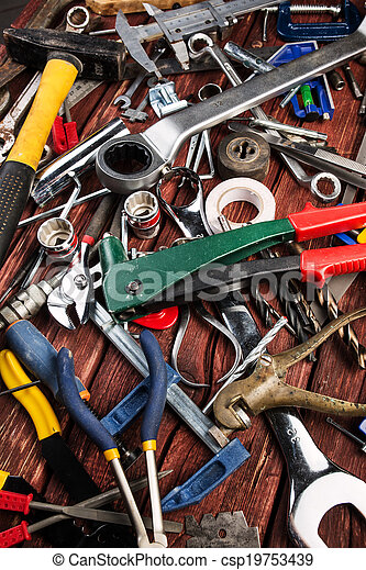 Set of different tools on wooden background - csp19753439
