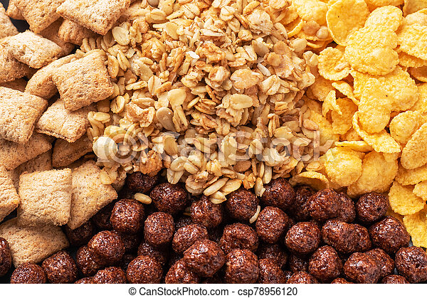 Set of dry cereal flakes for Breakfast with milk and berries. Healthy natural food. Background Close Up - csp78956120