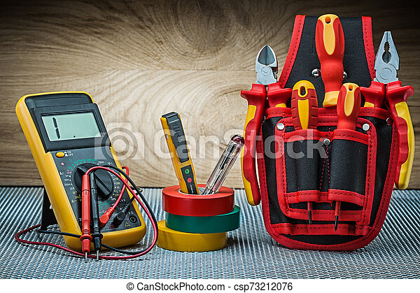 set of electrical tools on wood background - csp73212076