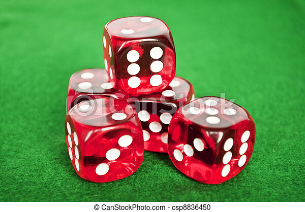 Set of gambling dices on green background - csp8836450