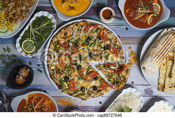 Set of healthy Indian food on a wooden table, top view. - csp89727646