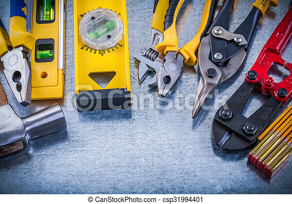 Set of house improvement tools on scratched metallic background - csp31994401