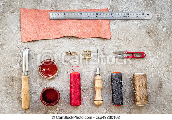 Set Of Leather Craft Tools On Grey Stone Background Top View