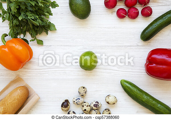 Set of raw healthy food on a white wooden background. Flat lay. Top view. From above. - csp57388060