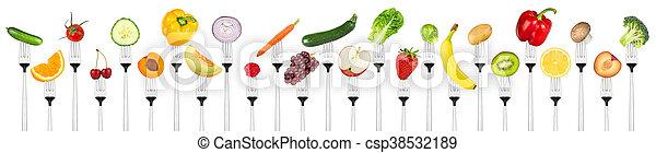 set of tasty fruits and vegetables on forks - csp38532189