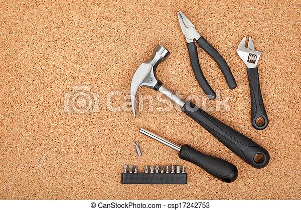 Set of tools on cork background - csp17242753