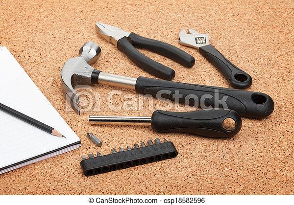 Set of tools on cork background - csp18582596