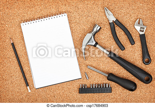 Set of tools on cork background - csp17684903