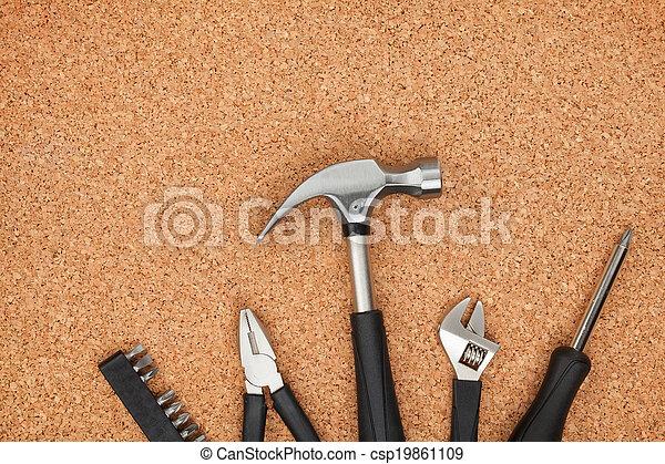 Set of tools on cork background - csp19861109