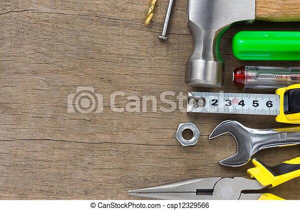 set of tools on wood background - csp12329566