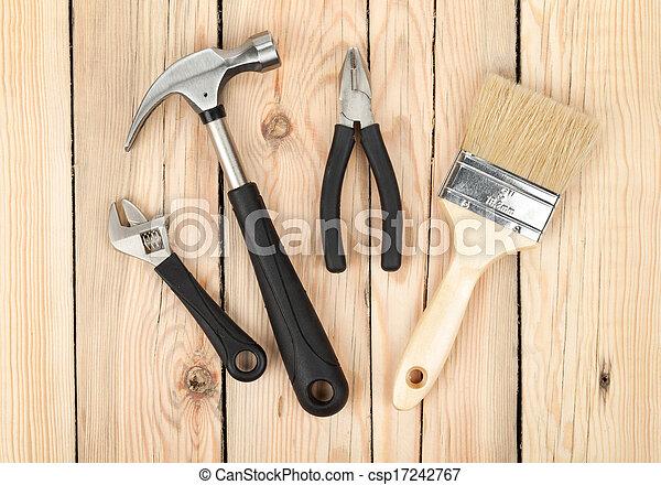 Set of tools on wood background - csp17242767