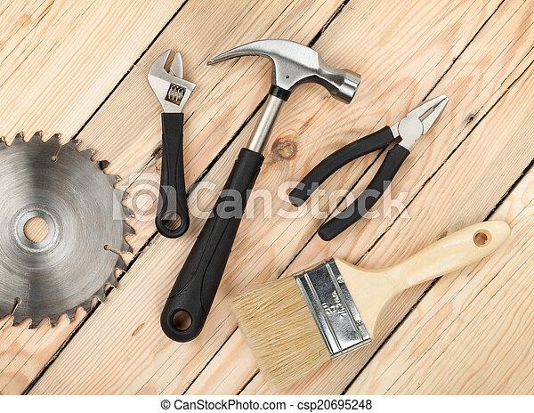 Set of tools on wood background - csp20695248