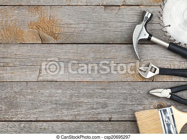 Set of tools on wood background - csp20695297