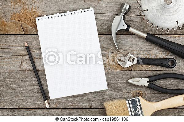 Set of tools on wood background - csp19861106